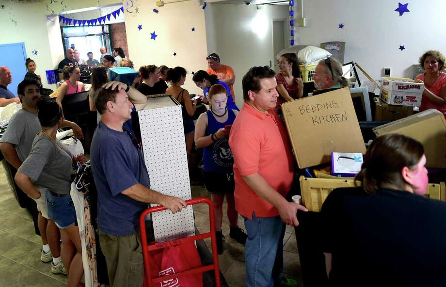 (Peter Hvizdak - New Haven Register) Fathers Frank Duffy of Bridgeport, left, and Nick LoPreiato (CQ) of Newington, right, wait in line for elevators as they help their daughters, seniors, move their belongings into the Southern Connecticut State University North Campus Mid-Rise residency hall during move-in-day at the S.C.S.U. in New Haven. Sunday, August 28, 2016. See the photo gallery at photos.newhavenregister.com. Photo: Peter Hvizdak / ©2016 Peter Hvizdak / ©2016 Peter Hvizdak