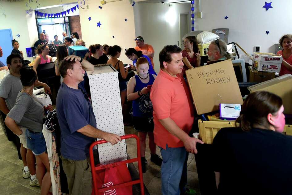 (Peter Hvizdak - New Haven Register) Fathers Frank Duffy of Bridgeport, left, and Nick LoPreiato (CQ) of Newington, right, wait in line for elevators as they help their daughters, seniors, move their belongings into the Southern Connecticut State University North Campus Mid-Rise residency hall during move-in-day at the S.C.S.U. in New Haven. Sunday, August 28, 2016. See the photo gallery at photos.newhavenregister.com.