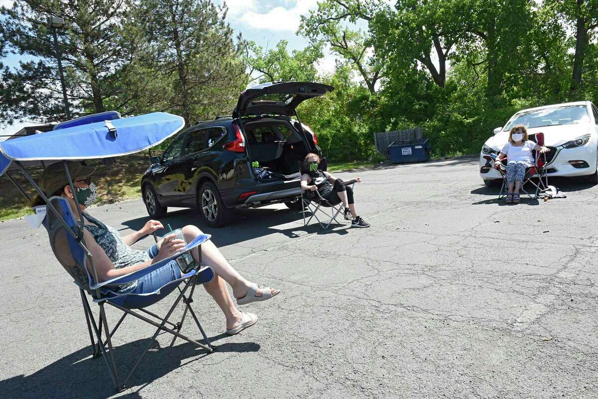 From left, gym buddies Fran Godgart of Castleton, Ann Button of Troy and Janis Fox of North Greenbush practice social distancing as they socialize in the parking lot of Metabolic on Friday, May 29, 2020 in Troy, N.Y. The group originally met in the Metabolic gym and the parking lot get-together is usually a lot larger. (Lori Van Buren/Times Union)