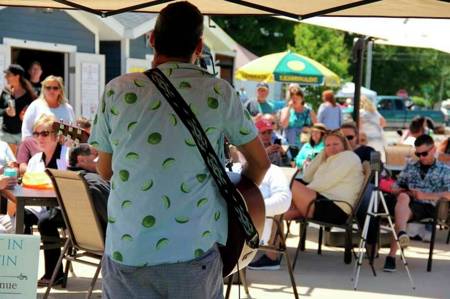 A musician performs before a crowd during last year's Porch Fest event in Port Austin. This year's event -- one of a select few still on the summer schedule -- will be held June 27. (Tribune File Photo)