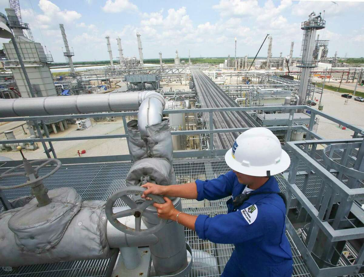 Plant Operators at the control room, pipes, towers and fractional facilities at Enterprise refinery in Mont Belvieu, Texas. The company received approval from the state to suspend some chemical leak monitoring during the pandemic at the facility.