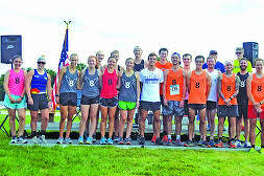 Pictured above are former members of the Edwardsville High School cross country program that returned to run at the 2018 Mud Mountain 5K at SIUE.