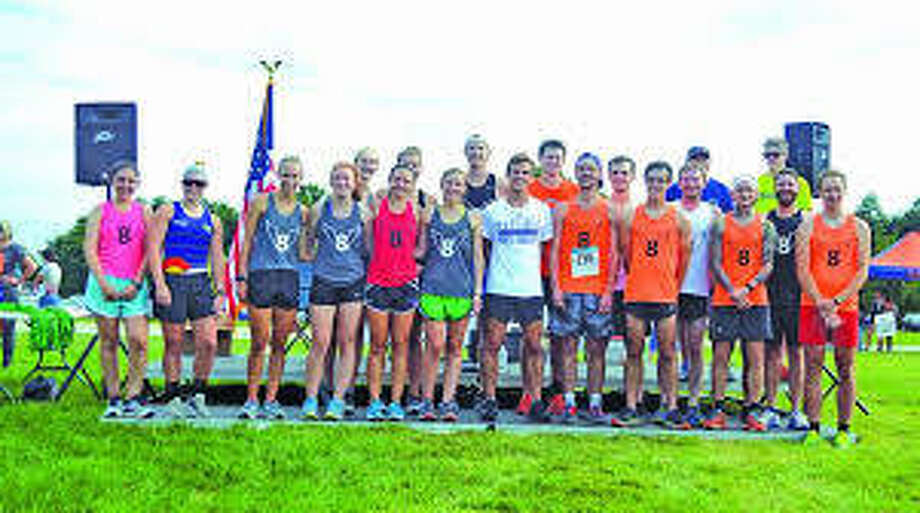 Pictured above are former members of the Edwardsville High School cross country program that returned to run at the 2018 Mud Mountain 5K at SIUE. Photo: Scott Marion/The Intelligencer