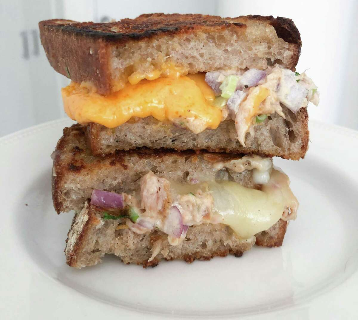 Tuna melt two ways: With Cheddar and with Jalapeño Jack, which the author preferred.