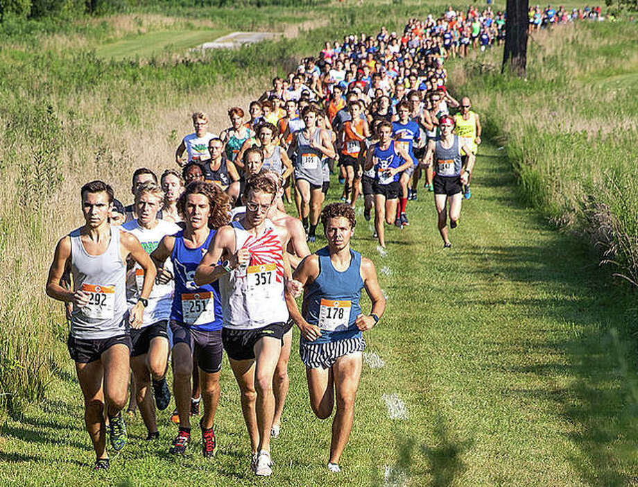 Runners take off from the starting line on July 27, 2019, during the 24th annual Mud Mountain 5K at the SIUE cross country course. Photo: Mike Baxter | For The Telegraph