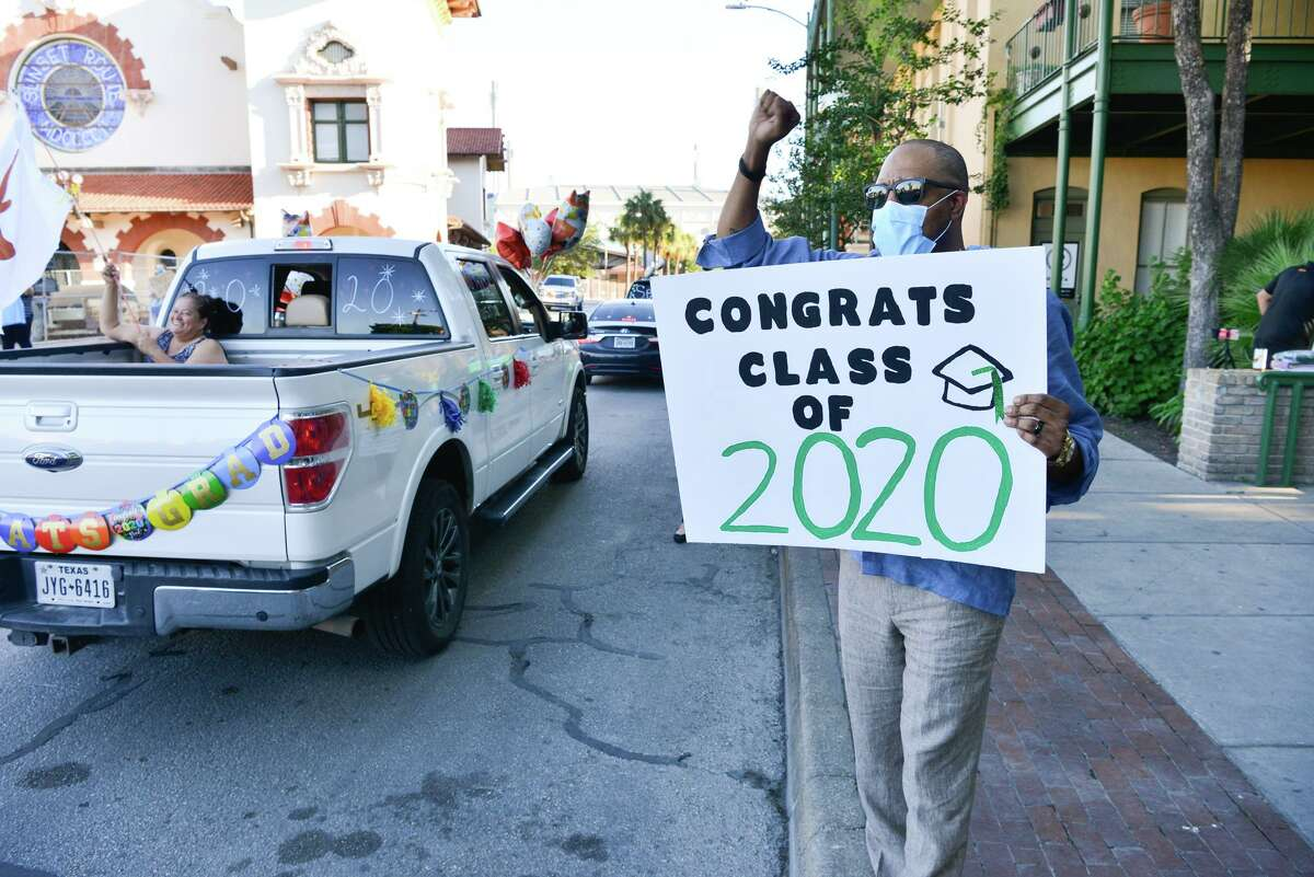 KIPP Texas-San Antonio Regional Superintendent Allen Smith cheers seniors during a drive-by celebration. This isn't the type of graduation anyone envisioned, but the Class of 2020 is a model of perseverance and rising to challenges.