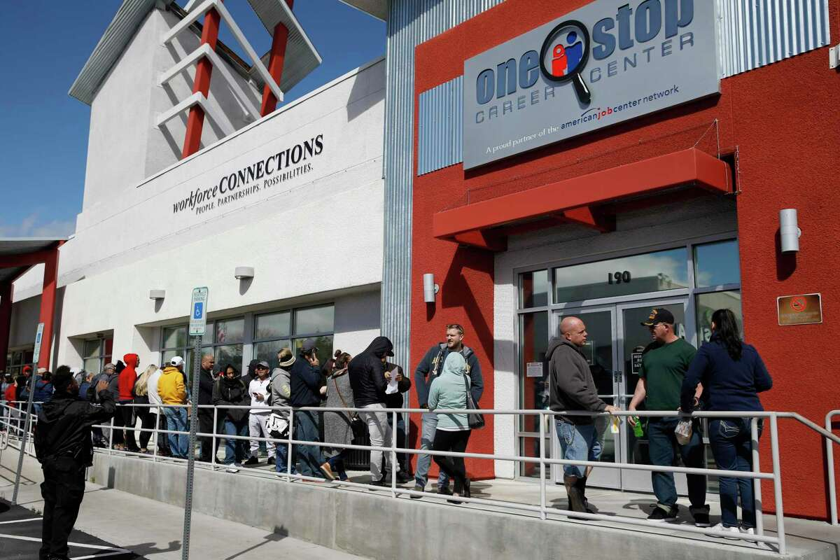 People wait in line for help with unemployment benefits at the One-Stop Career Center in Las Vegas, March 17. With unemployment estimated at 20 percent, similar to the Great Depression, the WPA is a better model of assistance.