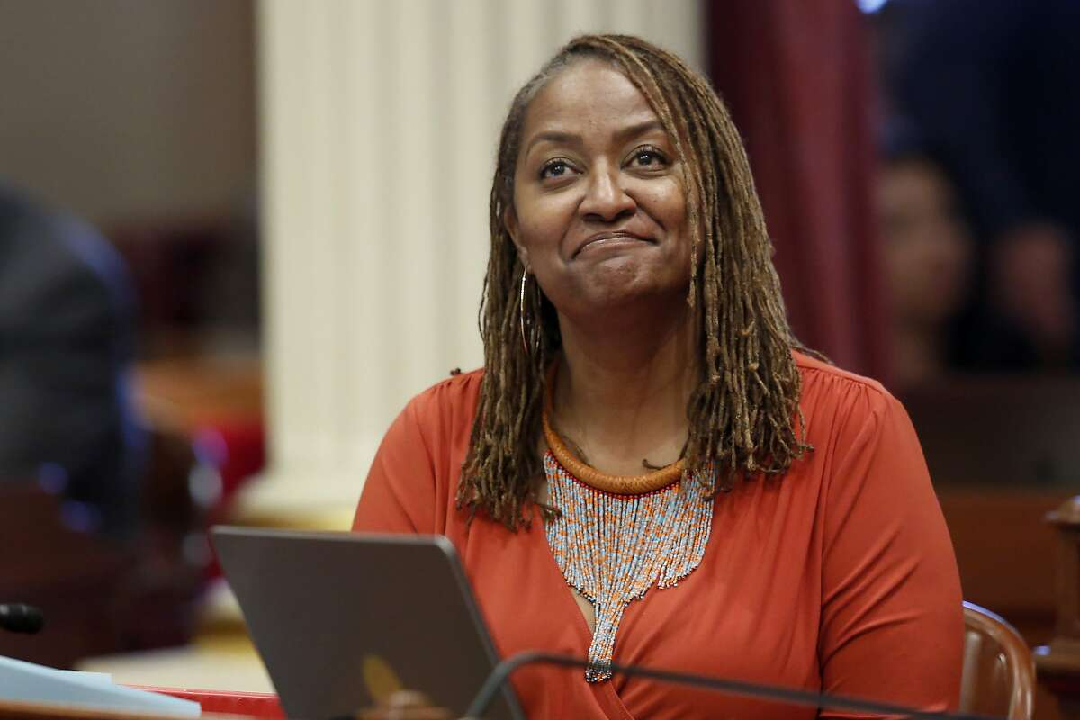 FILE - This July 8, 2019 file photo shows state Sen. Holly Mitchell, D-Los Angeles, in the Senate chamber in Sacramento, Calif. The California Senate's plan to cover a projected budget deficit rejects Gov. Gavin Newsom's proposed cuts to public education and health care programs. Newsom's plan would cut funding for public schools by about $8 billion. The Senate's plan would restore $2.7 billion of those cuts, the rest being deferred to future years. (AP Photo/Rich Pedroncelli, File)