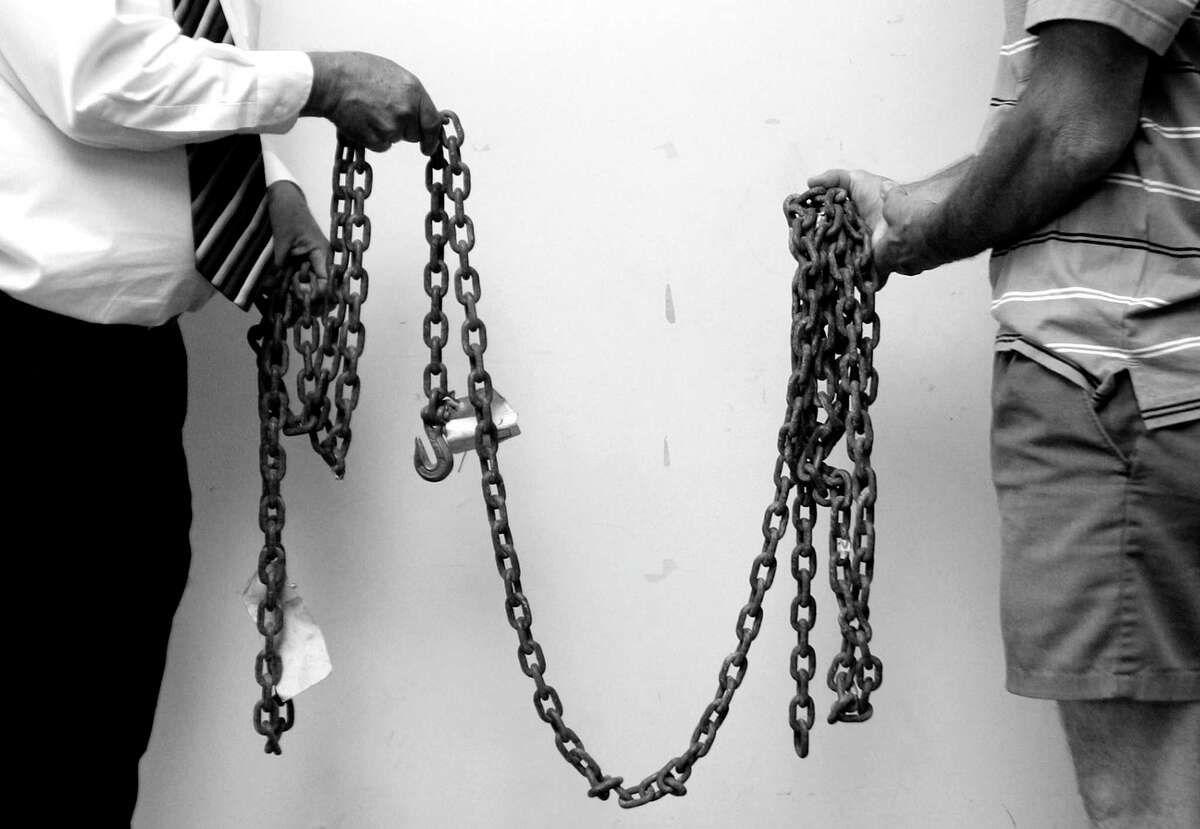 In 2008, Jasper County officials hold the chain used to drag James Byrd Jr.