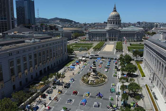 The homeless encampment along Fulton Street at the Civic Center on Saturday, May 23, 2020, in San Francisco, Calif. The city-sanctioned homeless encampment was set in place during the coronavirus pandemic. Social distancing rectangles drawn on the floor are an attempt to curb the spread of coronavirus.