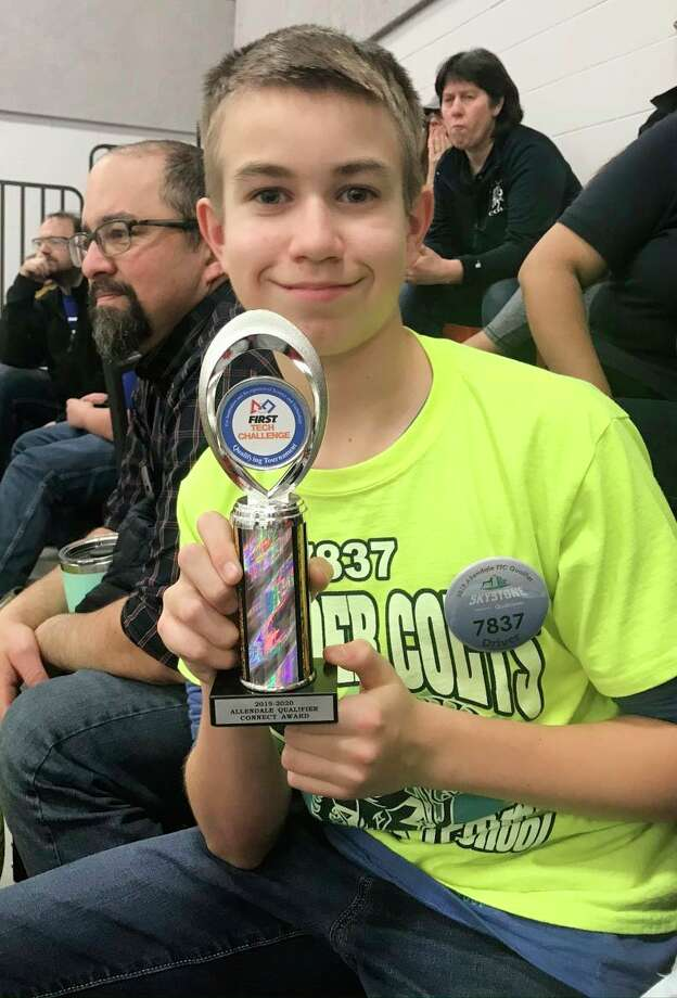 Austin Hinkley holds up the Allendale Qualifier Connect Award, from when he, and his team, made it to state for robotics. The St. Mary Catholic School student recently won a $10,000 scholarship for his leadership to the team and passion for learning. (Courtesy photo)