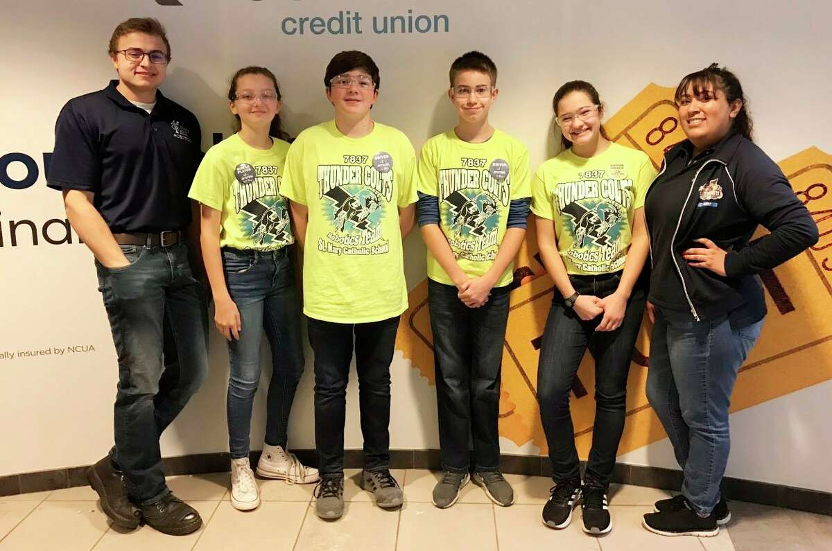 Hinkley is pictured with his robotics team. The group was supposed to compete in the state robotics competition, but the event was cancelled due to the coronavirus. (Courtesy photo)