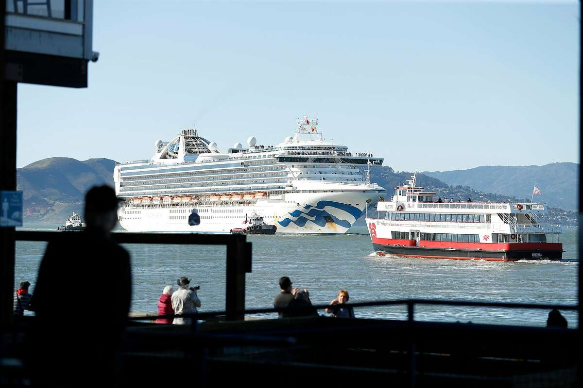 The Grand Princess passes Pier 39 as it arrives from Hawaii in San Francisco, Calif., on Tuesday, February 11, 2020.