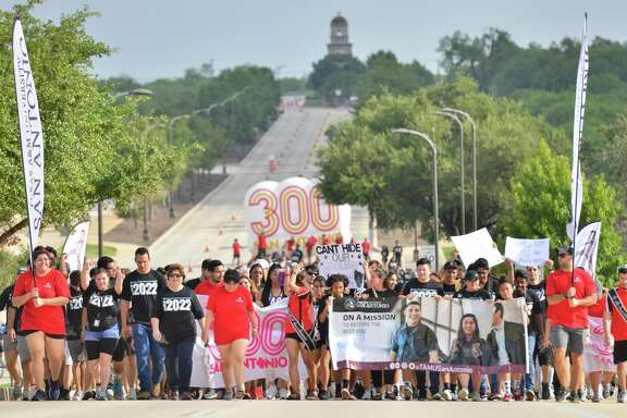 """Incoming Texas A&M freshman walk the """"Miracle Mile"""" from the Torre de Esperanza to the fountain where they were greeted by upperclassmen, faculty and staff as the school year starts at the south side campus."""
