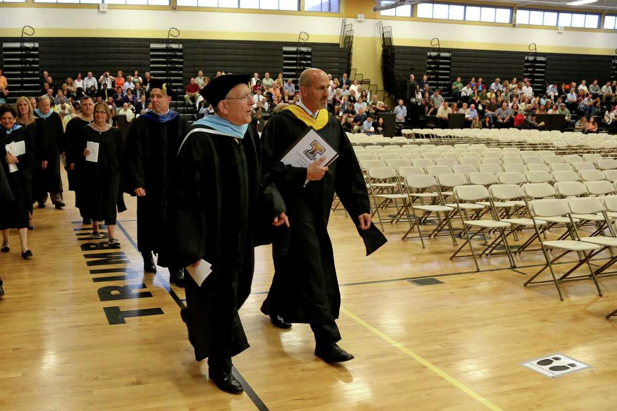 Trumbull High School Principal Marc Guarino and then-Superintendant of Schools Gary Cialfi lead the procession of faculty and students Trumbull High's 2015 graduation.