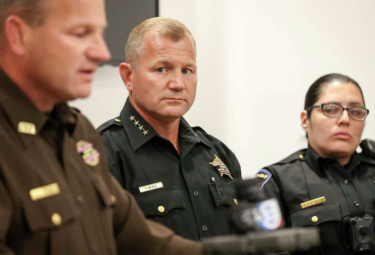 Fort Bend County Precinct 4 Constable Trever Nehls looks at his brother, Fort Bend County Sheriff Troy Nehls, during a press conference about the accidental shooting death of Precinct 4 Deputy Constable Caleb Rule on Friday, May 29, 2020, in Richmond. Earlier in the morning, a Fort Bend County Deputy Sheriff fatally shot Rule after mistaking him for an intruder as they cleared a house in nearby Missouri City. Rule was flown to Memorial Hermann hospital, but he did not survive.