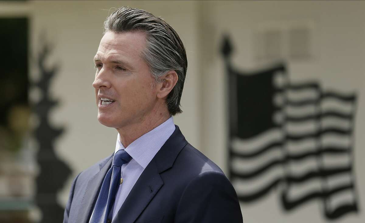 FILE - In this Friday, May 22, 2020, file photo, California Gov. Gavin Newsom speaks during a news conference at the Veterans Home of California in Yountville, Calif.