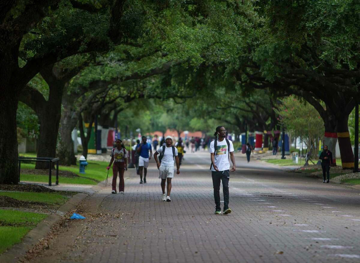 Students walk through the campus of Texas Southern University in Houston. A report says thousands of students who didn't meet the college's academic criteria were admitted.