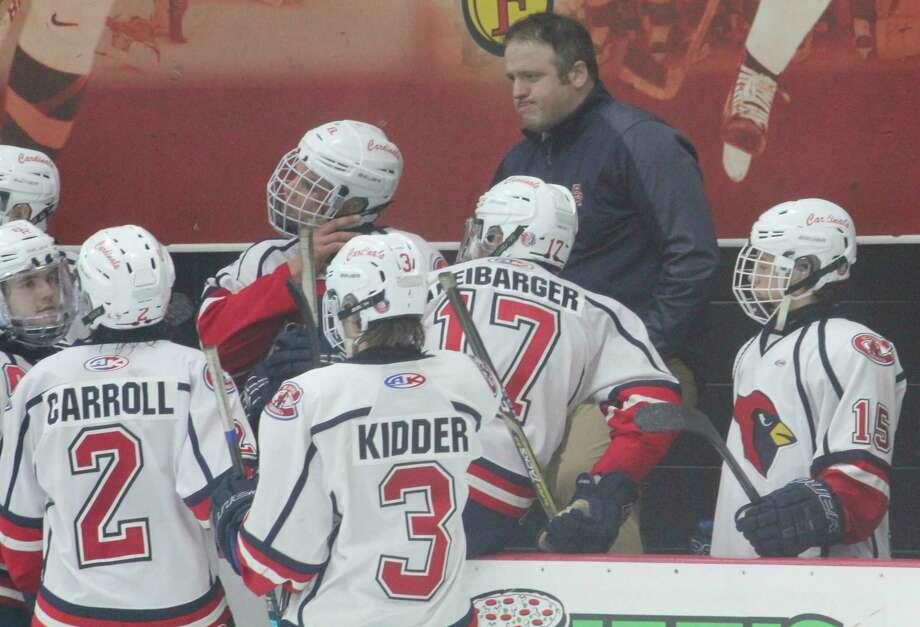 Big Rapids hockey coach Tim Blashill works with his team during a game last season. (Pioneer photo/John Raffel)