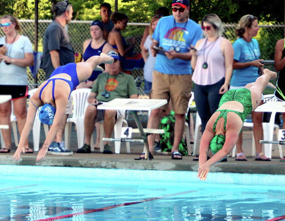 Timers keep as close eye as swimmers dive from the starting blocks at a Southwestern Illinois Swim Association meet last summer at Summers Port in Godfrey between the host Sharks and and the Collinsville Aqua Park Gators. Because of the COVID-19 pandemic, a vote will be held Saturday morning to determine SWISA's fate for this summer. Photo: Pete Hayes File Photo | The Telegraph