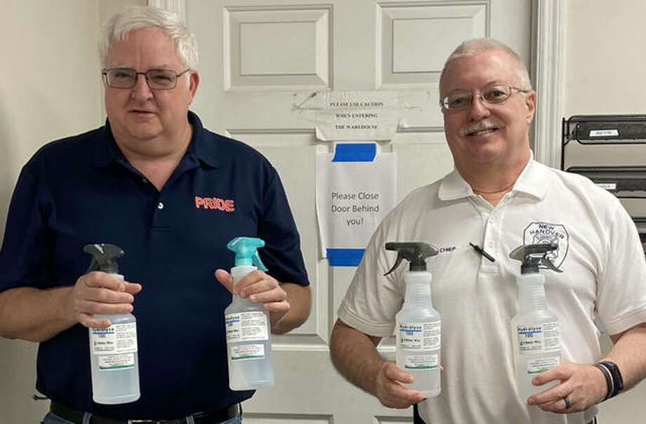 Jim Seubert, left, stands holding his product (Hydrolyze Disinfectant Spray) with one of his customers, New Hanover County Fire and Rescue deputy fire chief, Frank Meyer. New Hanover County encompasses Wilmington, North Carolina where Seubert has his second Pride Restoration location. Photo: Courtesy Of Jim Seubert