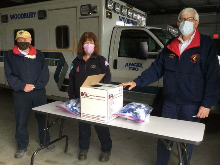 To assist local first responders during the current pandemic, on May 3, The Woodbury Lions Club donated masks and disinfectant concentrate to the Woodbury Volunteer Ambulance Association May 3, at the headquarters at 426 Main Street North. Photo: Contributed Photo