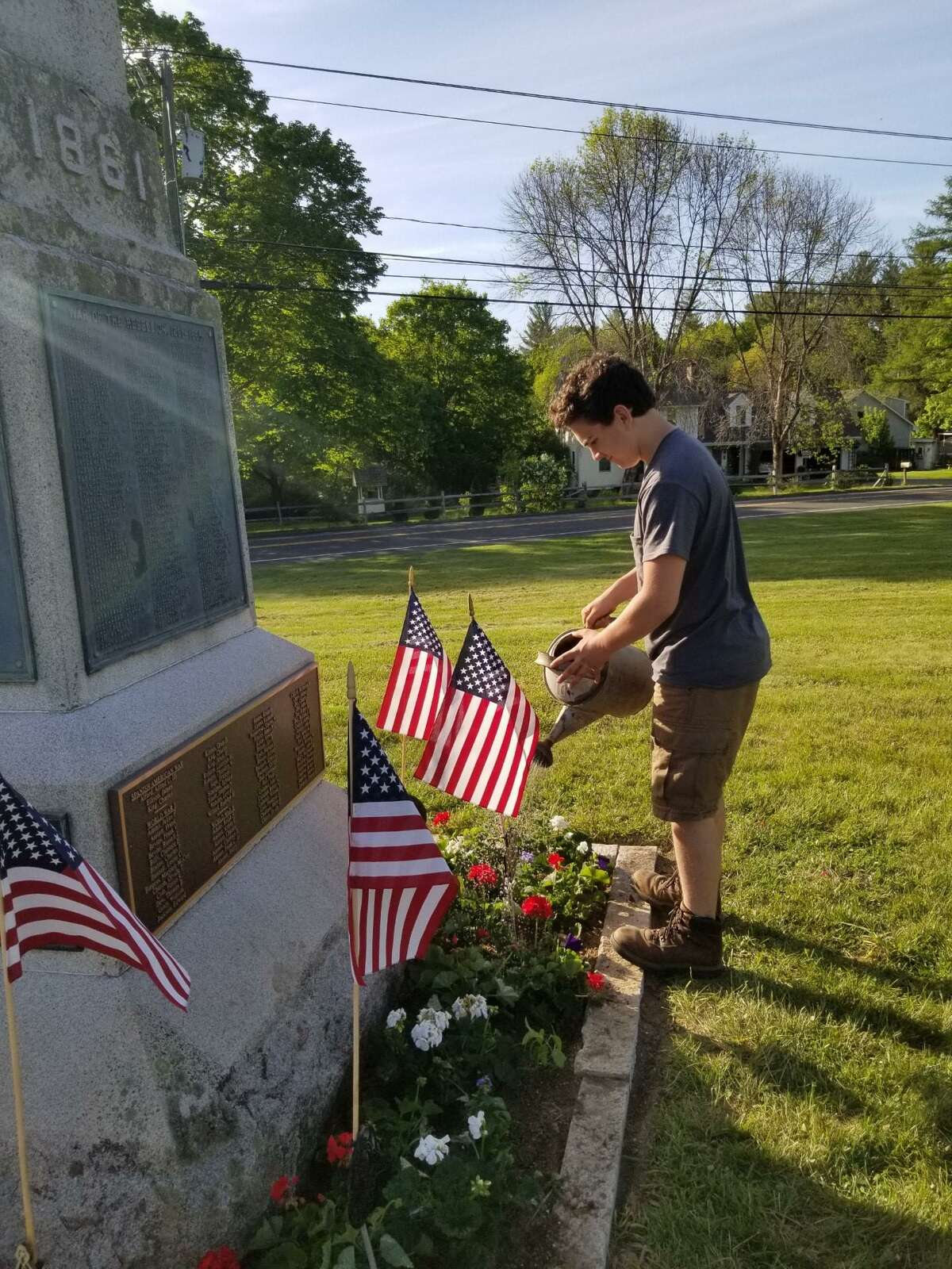 Students from the Northwestern Regional Agricultural Education FFA Program recently donated plants grown in their greenhouse and planted them at the Veteran's Memorial Monument in Barkahmsted in honor of Memorial Day. Above, freshman Joseph Caron waters the plantings.