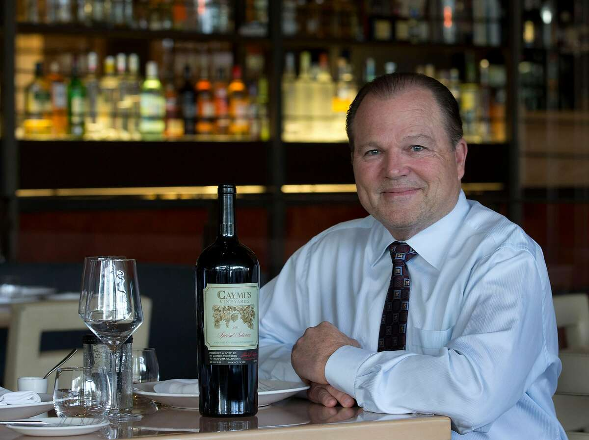 Napa Valley vineyard owner and winemaker Chuck Wagner sits with a bottle of his 2011 Caymus Vineyards Special Selection Cabernet Sauvignon in Miami Beach, Fla. on Thursday, Feb. 20, 2014. Wagner won Wine Spectator's Distinguished Service Award in 2007 and has numerous accolades from his very first vintages in the 1970s through the present. Wagner and Danny Meyer, CEO of Union Square Hospital Group will be honored at this year's tribute dinner during the South Beach Wine and Food Festival. (AP Photo/Wilfredo Lee)