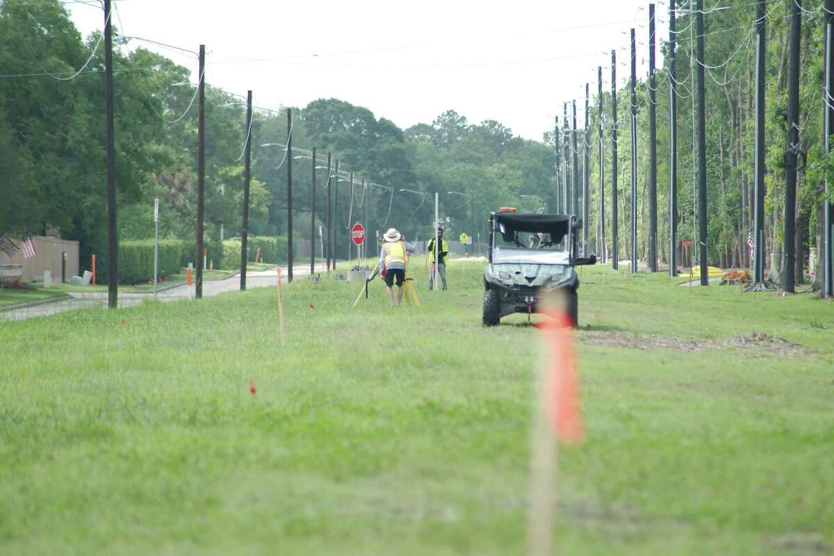 A survey crew works as a widening project for a section of El Dorado Boulevard gets underway.