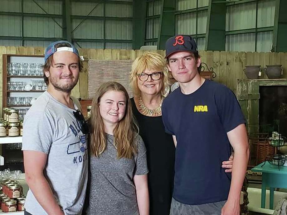 JoDell Langdon of the Columbiana Country Store in Eldred is shown with her grandchildren, from left, Carson Whitney, Emerson Blank and Harrison Whitney.
