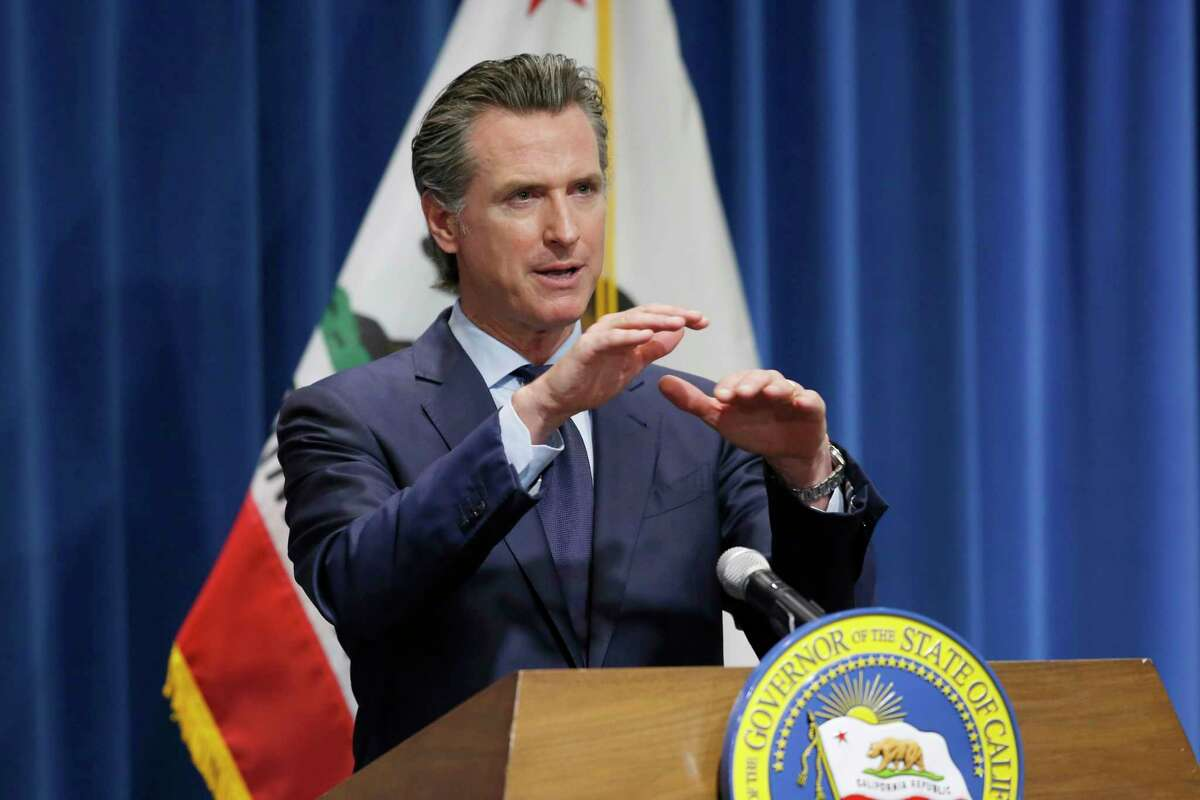 FILE - In this May 14, 2020, file photo, California Gov. Gavin Newsom discusses his revised 2020-2021 state budget during a news conference in Sacramento, Calif.