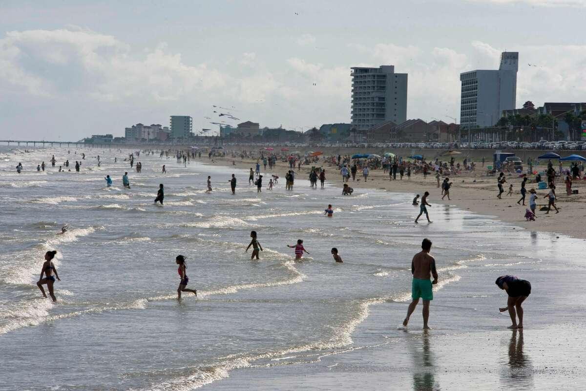 Beachgoers enjoy a day of sunshine at Galveston Beach.