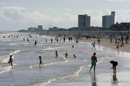 "Beachgoers enjoy a day of sunshine at Galveston Beach on May 2, 2020 in Galveston, Texas. - Texas beaches were ordered to be opened on May 1, 2020. In a statement, the City of Galveston said, ""The City of Galveston's top priority is the health of our residents. We strongly urge our residents to continue taking health precautions and following the CDC, state and health district guidelines regarding COVID-19, including social distancing and avoiding gatherings of more than 10."" The reopening is a first step in Galveston's goal to rebound from the pandemic and ""salvage the summer,"" as coined during the tourist town's."