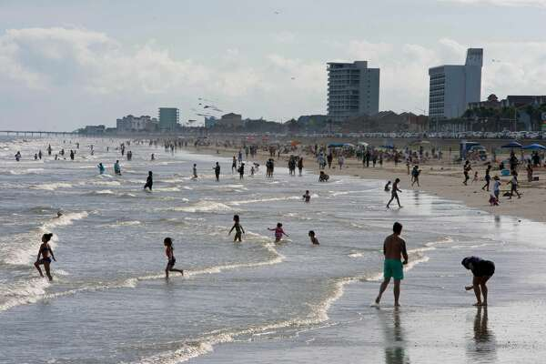 """Beachgoers enjoy a day of sunshine at Galveston Beach on May 2, 2020 in Galveston, Texas. - Texas beaches were ordered to be opened on May 1, 2020. In a statement, the City of Galveston said, """"The City of Galveston's top priority is the health of our residents. We strongly urge our residents to continue taking health precautions and following the CDC, state and health district guidelines regarding COVID-19, including social distancing and avoiding gatherings of more than 10."""" The reopening is a first step in Galveston's goal to rebound from the pandemic and """"salvage the summer,"""" as coined during the tourist town's."""