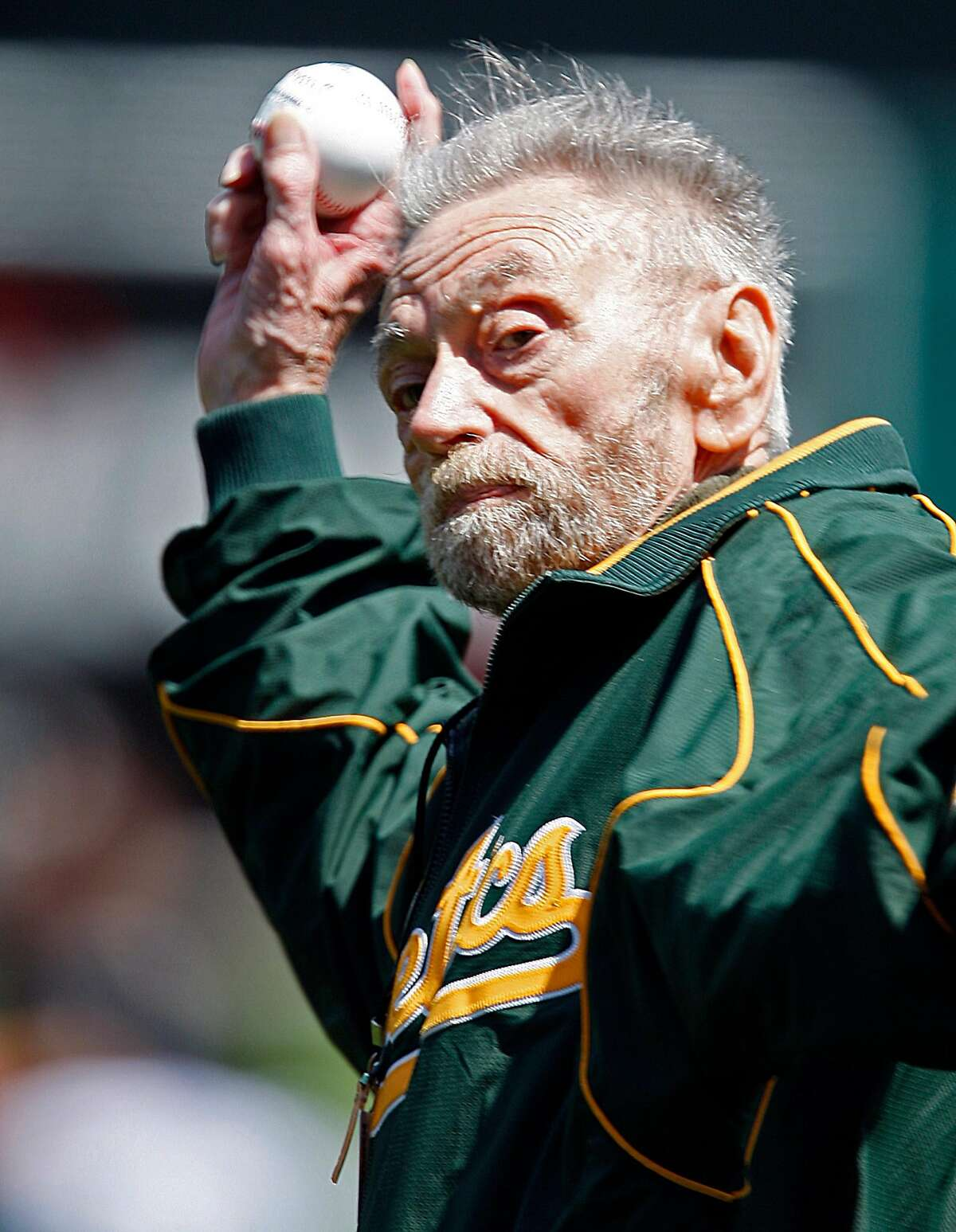 Oakland Athletics' longtime public address announcer Roy Steele throws out the ceremonial first pitch before a baseball game between the A's and the Baltimore Orioles, Saturday, April 17, 2010, in Oakland, Calif. (AP Photo/Ben Margot)