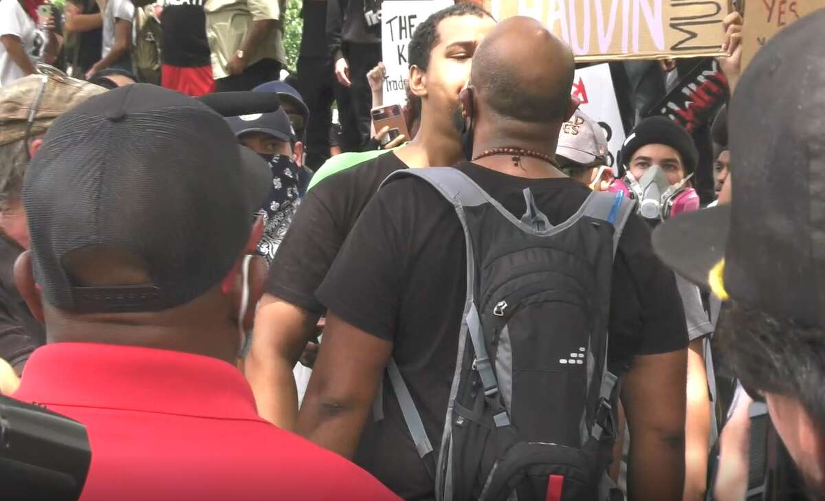 Video shows the beginning of a fight at a demonstration in Houston on May 29, 2020. People gathered at City Hall for the rally protesting the death of George Floyd in Minneapolis.