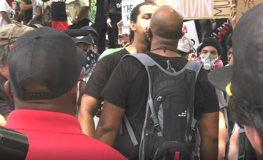 Video shows the beginning of a fight at a demonstration in Houston on May 29, 2020. People gathered at City Hall for the rally protesting the death of George Floyd in Minneapolis. Photo: Jay R. Jordan/Houston Chronicle