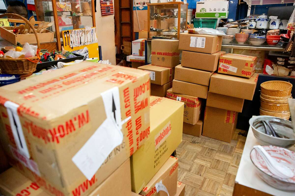 Dozens of boxes filled with online orders fill the back of the Wok Shop in China Town in San Francisco, Calif. on Friday, May 29, 2020 waiting to be sent out. Thanks to online sales, Tane Chan has been able to keep her shop open and running during the Shelter-In-Place orders. Chan worries what will happen to other small businesses who have not been able to maintain income through e-commerce and online sales.