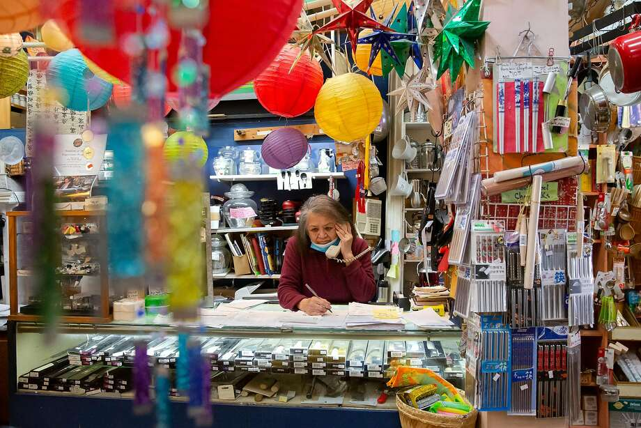 Tane Chan, owner of the Wok Shop in Chinatown, takes an order over the phone. Online sales are crucial to her business. Photo: Brittany Hosea-Small / Special To The Chronicle