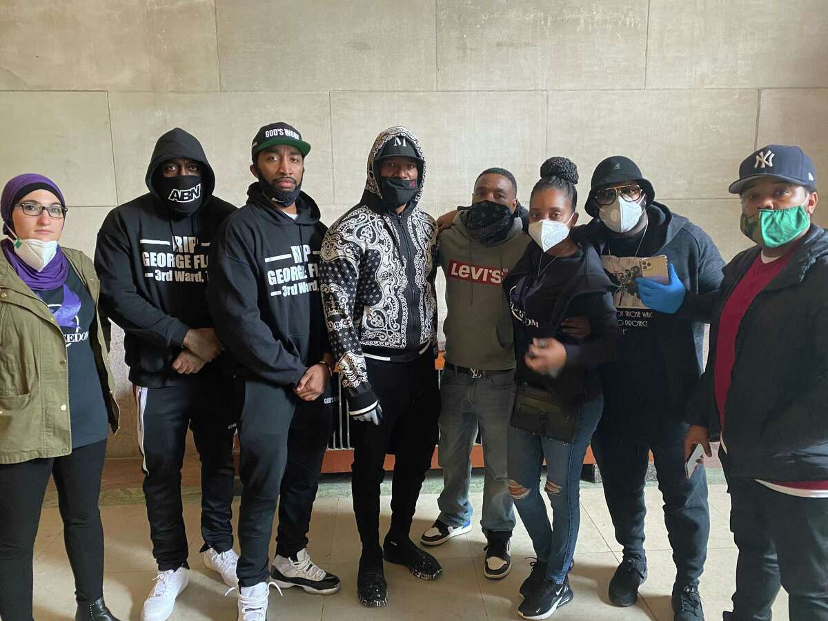 A group including Trae Tha Truth (second from left), Mysonne (third from left) and Jamie Foxx (fourth from left) attend rallies for George Floyd in Minneapolis on Friday, May 29, 2020.