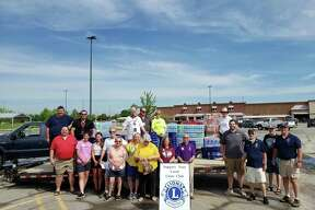 A group of Lions from a number of different clubs, including Auburn-Williams Township, gather at Sam's Club in Saginaw Township to pick up supplies to disperse to local flood victims. Sam's Club donated 2 pallets of bottled water to aid the relief effort. (Photo Provided)