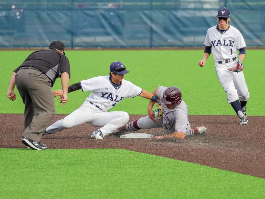 Yale's Dai Dai Otaka puts the tag on a Fordham baserunner. Looking on is Yale's Simon Whiteman. Photo: Yale University Athletics / Contributed Photo / Greenwich Time Contributed