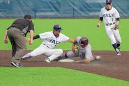Yale's Dai Dai Otaka puts the tag on a Fordham baserunner. Looking on is Yale's Simon Whiteman.