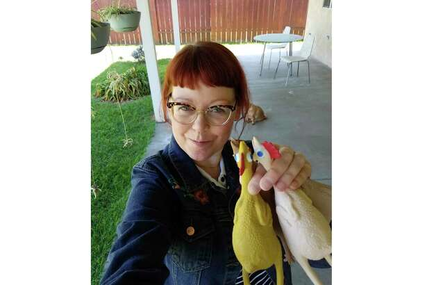 Melissa Jean Footlick of San Diego bought a game with rubber chickens online. Footlick is among millions who have helped online retail sales surge as consumer spending fell off rapidly when businesses shut down.