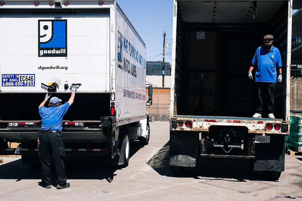 Workers prepare to load pallets of donated goods onto trucks at the Goodwill no-contact drop-off donation site on Thursday, May 28, 2020 in San Francisco, California.