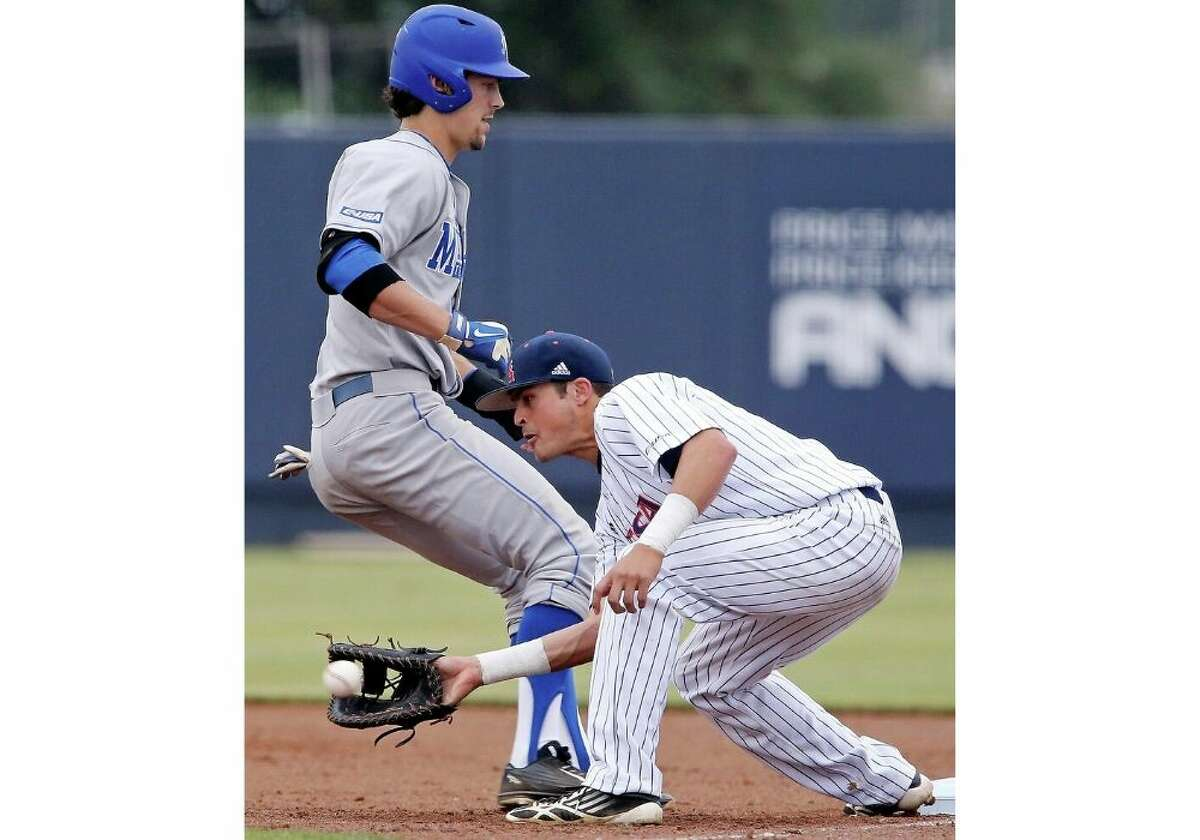 Middle Tennessee State University's Ronnie Jebavy beats the throw back to first base around UTSA's Matt Hilston Friday May 8, 2015 at Roadrunner Field on the UTSA campus.