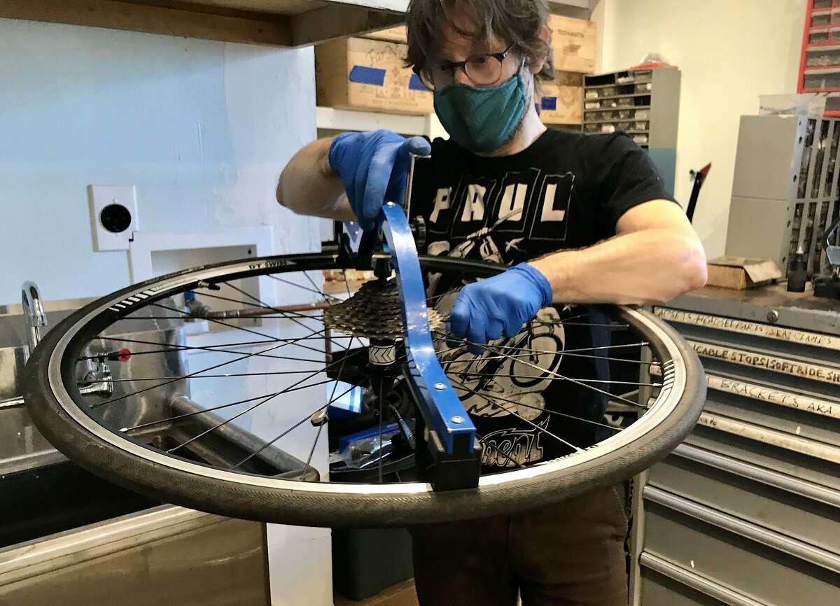 S.F. Bike mechanic Uri Friedman brings wobbly bike wheel back to life inside his shop