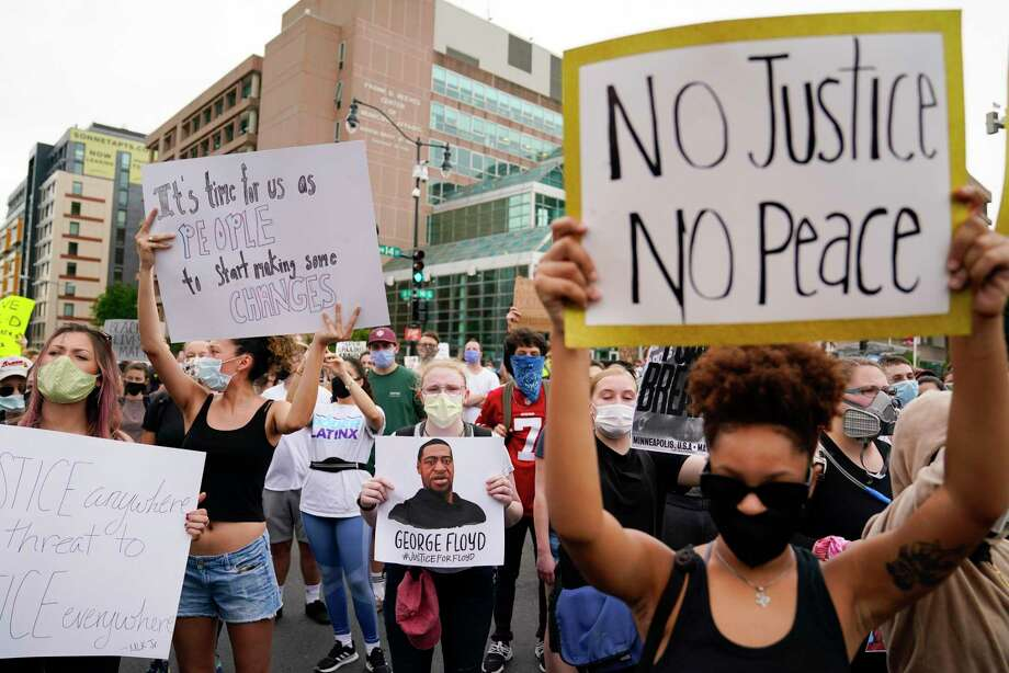 Demonstrators gather to protest the death of George Floyd, a black man who died in police custody in Minneapolis, at the corner of 14th and U streets in Washington, Friday, May 29, 2020. Photo: Evan Vucci / Associated Press / Copyright 2020 The Associated Press. All rights reserved