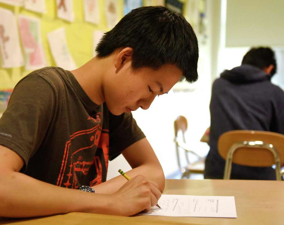 GHS Mathlete Zachary Wang works on a sample problem during after-school practice at Greenwich High School in Greenwich, Conn. Monday, June 11, 2018. Photo: File / Tyler Sizemore / Hearst Connecticut Media / Greenwich Time