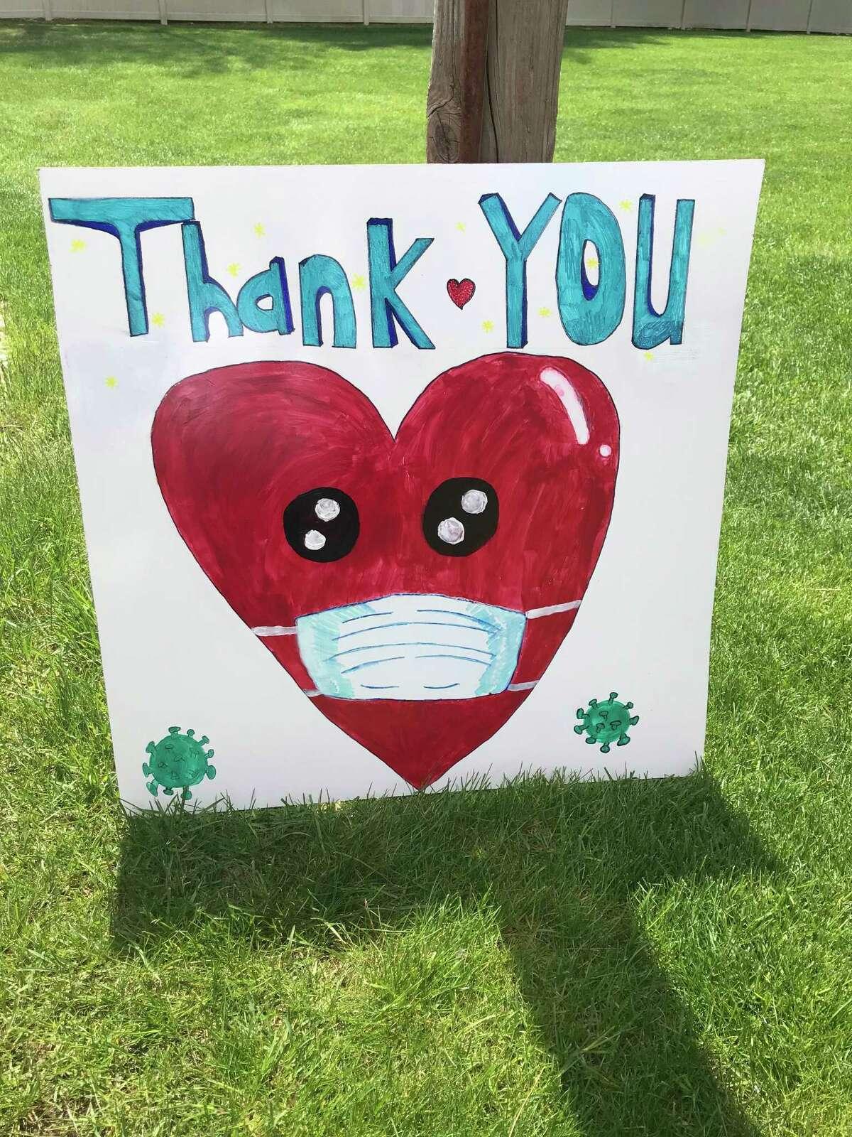 Shelton Intermediate School student Dimitri Mysirlidis created signs thanking essential workers.
